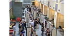 Researchers present and discuss their work in the atrium of Duffield Hall at Cornell University.