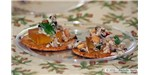 Gourmet crackers with mango paste and sauteed ant brood with peanuts, mint, and red pepper