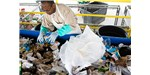 Inmate sorts garbage to filter recyclable materials at the Stafford Creek Correctional Center.