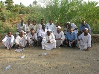 Health workers pose with villagers from Abu Hamad, Sudan, where a concerted and coordinated effort stopped the transmission of river blindness.
