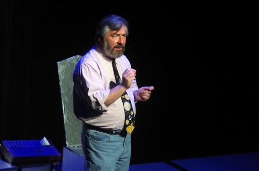 """Science writer Greg Scheiderer introducing the play """"Asteroids of Love"""" by Jennifer Dice, directed by Catherine Blake Smith."""