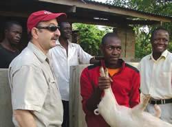 <figcaption>Max Rothschild (left) in Uganda. Credit: courtesy of Max Rothschild</figcaption>