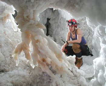<figcaption>Hazel Barton with a gypsum formation. Credit: Courtesy of Dave Bunnell / Under Earth Images</figcaption>