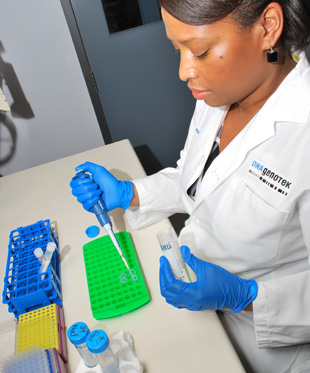 Rama Panford-Walsh, Ph.D., Product Development Scientist at DNA Genotek Inc. is extracting DNA from the company's Oragene saliva-based collection device.