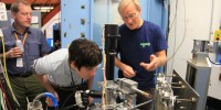 Bill Sellers (left), Holly Barden (center) and Uwe Bergmann (right), align the apparatus in order to get an accurate reading.