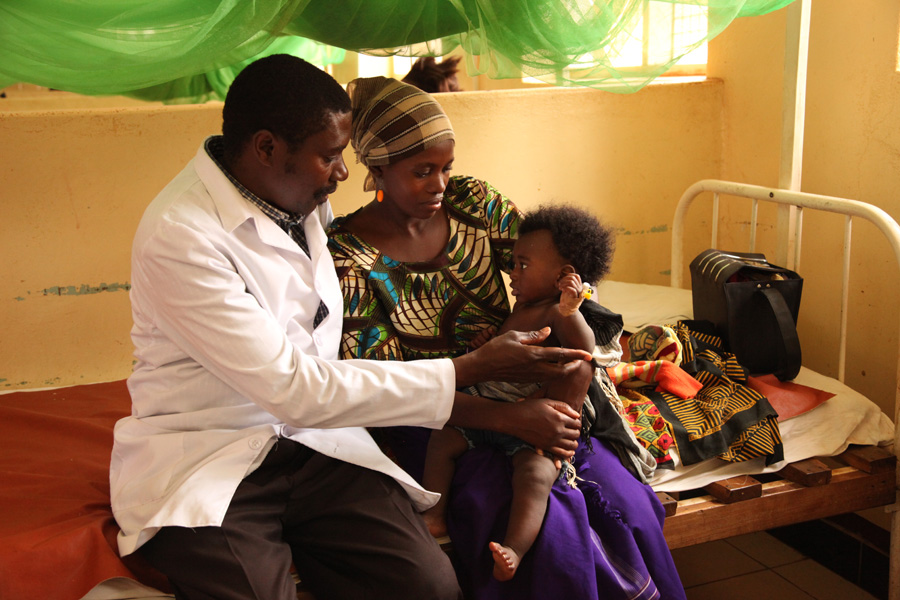 Dr Lusingu attending to children with malaria in the pediatric ward of the Korogwe District Hospital in Tanzania.