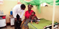 Dr. Lusingu attending to children with malaria in the pediatric ward of the Korogwe District Hospital in Tanzania.