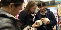 Grace, Katie, and Rohan collecting tea samples at a local supermarket. Cold Spring Harbor Laboratory
