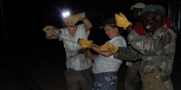 Vodzak, Reeder, and wildlife officer Wurube Alison retrieve bats from a triple-high mist net after a successful night of trapping. Courtesy of DeeAnn Reeder