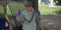 Reeder holding a highly poisonous black mamba snake killed by the nightwatchman she had hired to protect the family compound from both human and animal intruders. The nightwatchman would sleep in a tent in the middle of the compound with a machete and a bow and arrow at arm's reach.