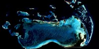 The Millennium Coral Reef Mapping project created the first ever map of coral reefs around the world using more than 1,000 coastal images obtained from the Landsat 7 satellite, such as this coral reef system in Los Roques, Venezuela.