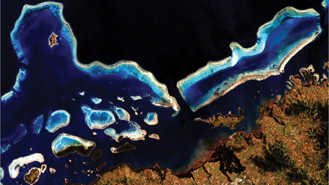 CORALS OF THE WORLD: By measuring and counting coral reefs in each 30-meter x 30-meter pixel of the more than 1,000 coastal images obtained from the Landsat 7 satellite, such as the coral reef system in Vanua Levu, Fiji pictured here, researchers estimated the total area of Earth's coral reefs to be around 250,000 square kilometers.