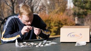 LAB AL FRESCO: A student explores a LabPaq Geology experiment.