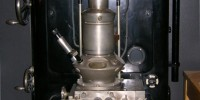 In 1933, Ernst Ruska built the first electron microscope capable of exceeding the magnification capabilities of optical microscope. The image shown here is a replica of the 1933 Ruska EM.