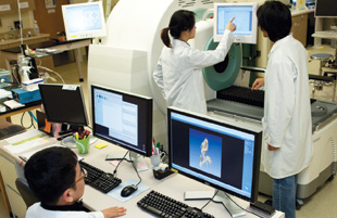 NEW USES FOR PET/CT: Researchers at UCSF, like those depicted here, use a PET/CT scanner to track the distribution of their therapy throughout cancer tissue.