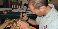 Javier Lopez, veterinarian for the Durrell Wildlife Conservation Trust, helping in the ploughshare captive breeding centre at Ampijoroa in MadagascarDurrell Wildlife Conservation Trust