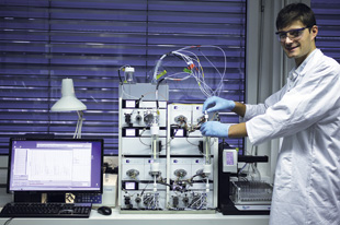 MIXING IT UP: Affinity chromatography can be simplified by using mixed-mode resins. In this photo an employee of ChromaCon AG is using a 2-column lab-scale unit of the company's ContiChrom platform.