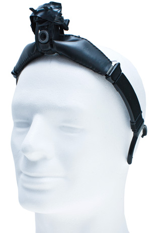 EYES AND EARS: The original version of the eyeborg used a computer webcam to detect light, a laptop to compute the conversion to sound, and headphones to transmit that sound to Harbisson's ears.