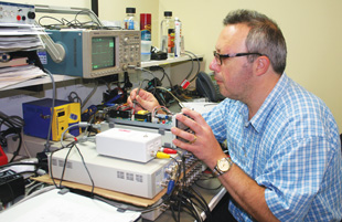 INDUSTRY LEADER: Sal Sadoti,one of several engineering technicians at #1-ranked ADInstruments, tests a prototype of a new software-controlled isolated stimulator.