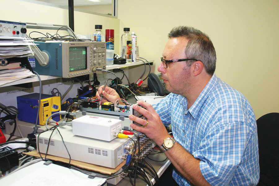 Sal Sadoti, one of several engineering technicians at #1-ranked ADInstruments, tests a prototype of a new software-controlled isolated stimulator.