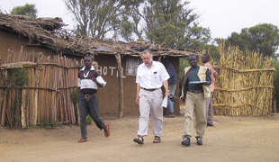 FIELD WORK: Thomas Elbert (middle) leaves his modest hotel with his translator Moses Nsamba (right).