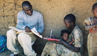 STRESS TESTING: Moses Nsamba  administers a memory test to a Rwandan refugee at the Nakivale refugee camp in Uganda.