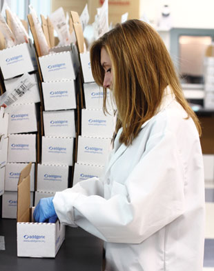 WORLDWIDE SHARING: An Addgene scientist prepares the day's plasmid shipment. Approximately 1,500 plasmids are shipped each week to laboratories around the world.