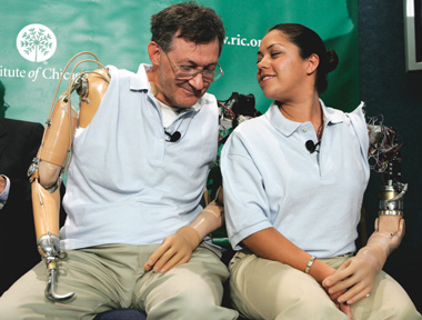 TOUCH PIONEERS: Amputees Claudia Mitchell and Jesse Sullivan talk during a September 2006 press conference at the National Press Club. Both underwent a revolutionary surgery that allowed them to feel their missing hands by transplanting sensory nerves into their upper chests.